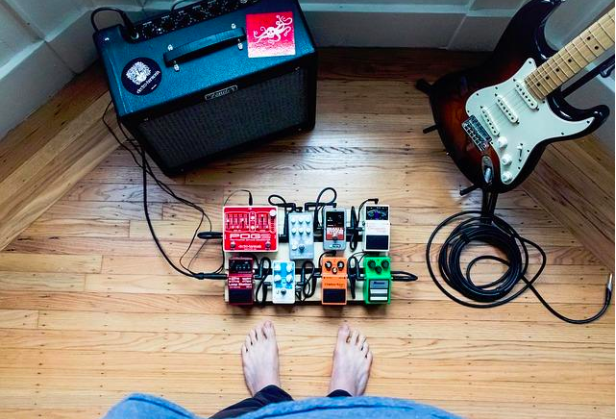 guitar pedalboard and amp